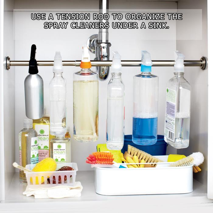 Use a tension rod to organize the spray cleaners under a sink